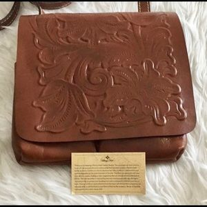 Brown Patricia Nash tooled leather crossbody.